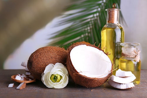 Coconuts and coconut oil on wooden table, beauty tips with coconut oil, 160 uses for coconut oil, beauty uses for vaseline, beauty uses for olive oil, coconut oil hair mask, coconut oil uses, coconut oil face mask, coconut oil before makeup,