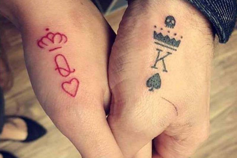Finger tattoos of King and Queen card