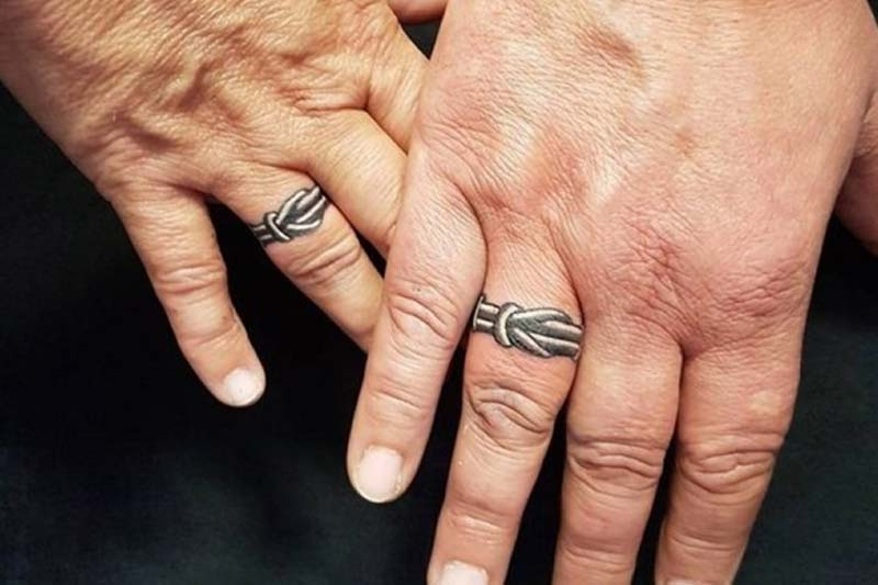 Black and white ring tattoos